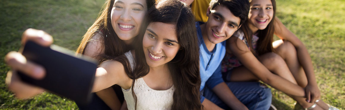 Teenagers taking a selfie photo